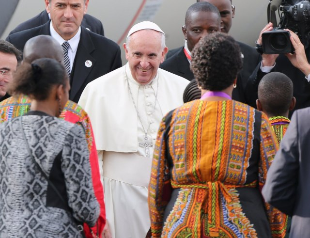 Pope Francis arrives for his first papal visit to the African Continent as head of the Catholic Church, at the Jomo Kenyatta International Airport in Nairobi November 25, 2015. REUTERS/Goran Tomasevic