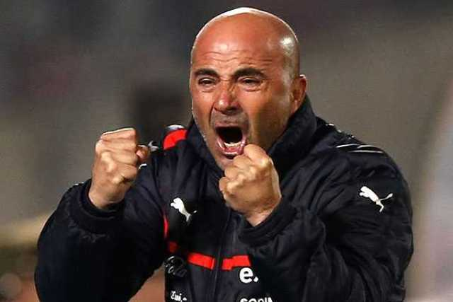 Chile's head coach Jorge Sampaoli celebrates a goal by his team during a 2014 World Cup qualifying soccer match against Bolivia in Santiago June 11, 2013.   REUTERS/Ivan Alvarado (CHILE - Tags: SPORT SOCCER)