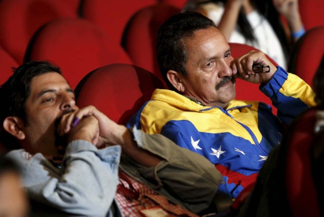 Supporters of Venezuela's President Nicolas Maduro react as National Electoral Council (CNE) President Tibisay Lucena announces the official results of parliamentary elections in Caracas, December 7, 2015. Venezuela's opposition won control of the legislature from the ruling Socialists for the first time in 16 years on Sunday, giving them a long-sought platform to challenge President Nicolas Maduro. REUTERS/Marco Bello FOR EDITORIAL USE ONLY. NO RESALES. NO ARCHIVE.