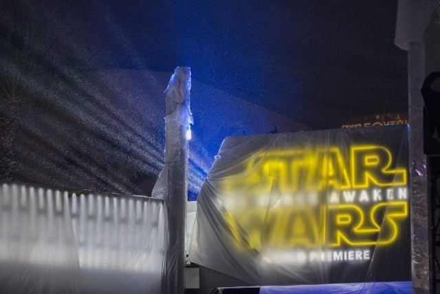 """LOS ANGELES, CA - DECEMBER 13: Rain falls on the entrance to the blocks-long tenting set up for the premiere of Walt Disney Pictures And Lucasfilm's """"Star Wars: The Force Awakens"""" on December 13, 2015 in the Hollywood section of Los Angeles, California.   David McNew/Getty Images/AFP"""