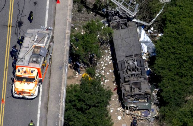 Aerial view of the overturned bus which crashed in the northern Argentina's city of Rosario de la Frontera
