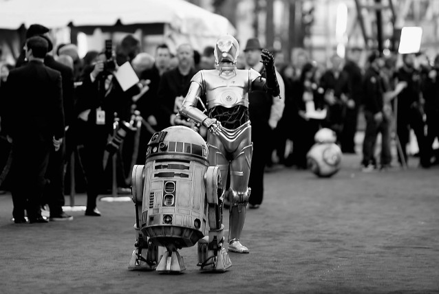 "HOLLYWOOD, CA - DECEMBER 14: (EDITORS NOTE: Image was coverted to black and white) R2-D2 and C-3PO attend The Premiere of Walt Disney Pictures and Lucasfilm's ""Star Wars: The Force Awakens"" on December 14, 2015 in Hollywood, California.   Jason Merritt/Getty Images/AFP"