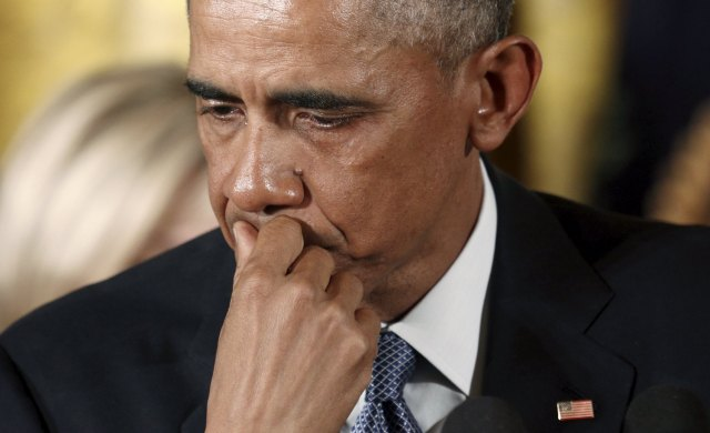U.S. President Barack Obama reacts while talking about Newtown and other mass killings during an event held to announce new gun control measures at the White House in Washington January 5, 2016.  The White House unveiled gun control measures on Monday that require more gun sellers to get licenses and more gun buyers to undergo background checks, moves Obama said were well within his authority to implement without congressional approval. REUTERS/Kevin Lamarque