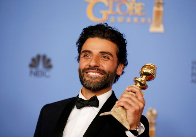 "Oscar Issac poses backstage with the award for Best Performance by an Actor in a Limited Series or a Motion Picture Made for Television for his role in ""Show Me a Hero"" during the 73rd Golden Globe Awards in Beverly Hills, California January 10, 2016.  REUTERS/Lucy Nicholson"