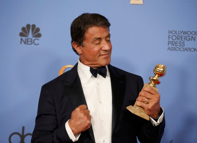 """Sylvester Stallone poses backstage with the award for Best Performance by an Actor in a Supporting Role in any Motion Picture for his role in """"Creed"""" at the 73rd Golden Globe Awards in Beverly Hills, California January 10, 2016.  REUTERS/Lucy Nicholson"""