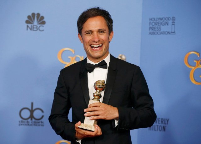 "Actor Gael Garcia Bernal poses backstage with the award for Best Performance by an Actor in a Television Series - Musical or Comedy for his role in ""Mozart in the Jungle"" at the 73rd Golden Globe Awards in Beverly Hills, California January 10, 2016.  REUTERS/Lucy Nicholson"