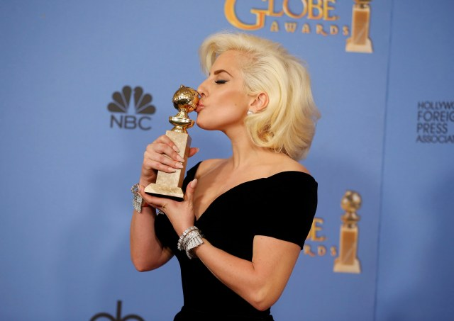 """Lady Gaga poses with the award for Best Performance by an Actress in a Limited Series or a Motion Picture Made for Television for her role in """"American Horror Story- Hotel"""" during the 73rd Golden Globe Awards in Beverly Hills, California January 10, 2016.  REUTERS/Lucy Nicholson"""