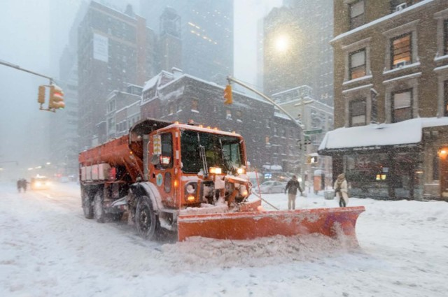 A snowplow clears snow on Lexington Avenue during the snowstorm January 2016 in New York. A deadly blizzard with bone-chilling winds and potentially record-breaking snowfall slammed the eastern US on Saturday, as officials urged millions in the storm's path to seek shelter -- warning the worst is yet to come. / AFP / FRANCOIS XAVIER MARIT