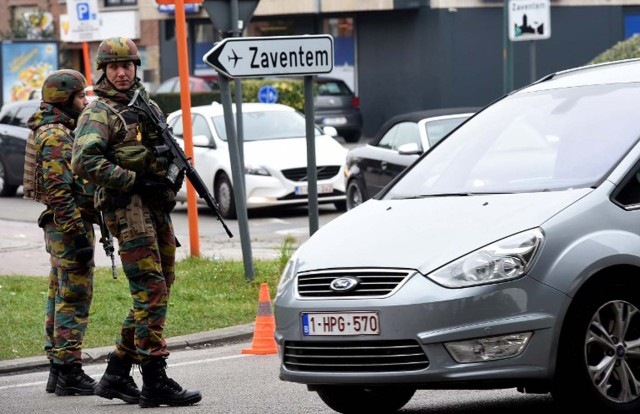 Belgian troops man a checkpoint outside Brussels airport in Zaventem on March 24, 2016, two days after terror attacks in the Belgian capital. Police in Brussels ramped up a desperate hunt for a fourth man suspected of taking part in the Islamic State bombings that struck at the very heart of Europe. Flags in the shellshocked city of Brussels hung at half-mast as Belgium mourned the 31 people from all over the world killed in the attacks, while doctors battled to save scores more injured in the carnage. / AFP / PATRIK STOLLARZ