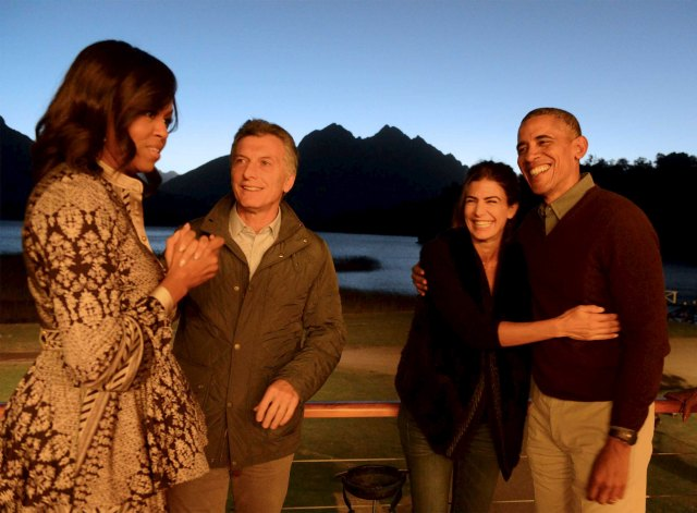 U.S. President Barack Obama (R) and First Lady Michelle Obama (L) talk with Argentine President Mauricio Macri and his wife Juliana Awada before departing from San Carlos de Bariloche for Buenos Aires, from where the Obamas will return to the United States, March 24, 2016. REUTERS/Argentine Presidency/Handout via Reuters ATTENTION EDITORS - THIS PICTURE WAS PROVIDED BY A THIRD PARTY. REUTERS IS UNABLE TO INDEPENDENTLY VERIFY THE AUTHENTICITY, CONTENT, LOCATION OR DATE OF THIS IMAGE. FOR EDITORIAL USE ONLY. NOT FOR SALE FOR MARKETING OR ADVERTISING CAMPAIGNS. THIS PICTURE IS DISTRIBUTED EXACTLY AS RECEIVED BY REUTERS, AS A SERVICE TO CLIENTS