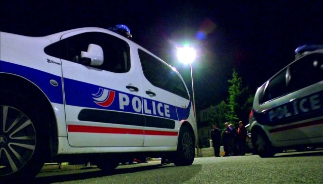 Still image taken from video shows Police vehicles at the scene near where a French police commander was stabbed to death in front of his home in the Paris suburb of Magnanville, France, June 14, 2016. REUTERS/Reuters TV