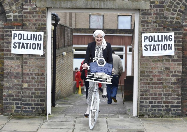 A woman cycles out of a polling station for the Referendum on the European Union in Chelsea, London, Britain, June 23, 2016. REUTERS/Toby Melville