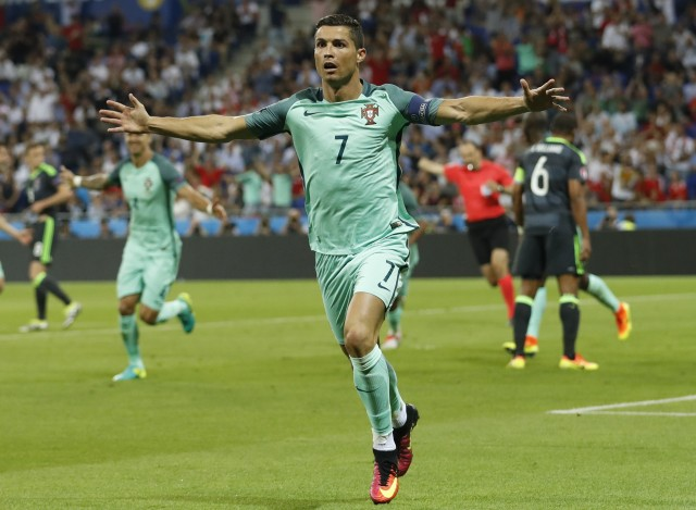 Football Soccer - Portugal v Wales - EURO 2016 - Semi Final - Stade de Lyon, Lyon, France - 6/7/16 Portugal's Cristiano Ronaldo celebrates after scoring their first goal  REUTERS/Carl Recine Livepic