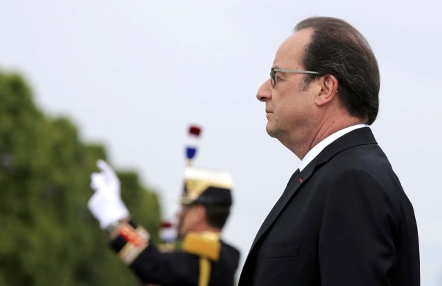 French President Francois Hollande reviews the troops on the Champs Elysees Avenue during the Bastille Day military parade in Paris, France, July 14, 2016.   REUTERS/Thibault Camus/Pool