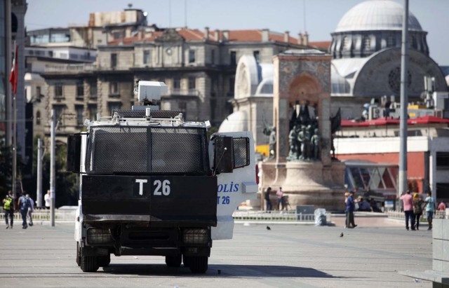 A police vehicle is parked beside the Republic Monument at Taksim Square in Istanbul after an attempted coup in Turkey, July 16, 2016. REUTERS/Kemal Aslan