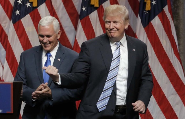 Republican U.S. presidential candidate Donald Trump introduces Indiana Governor Mike Pence (L) as his vice presidential running mate in New York City, U.S., July 16, 2016. REUTERS/Brendan McDermid