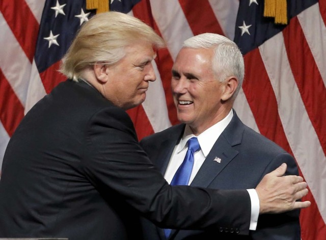 Republican U.S.presidential candidate Donald Trump (L) embraces Indiana Governor Mike Pence after introducing Pence as his vice presidential running mate in New York City, U.S., July 16, 2016. REUTERS/Brendan McDermid