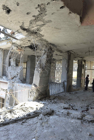 A man stands inside the destroyed parliament building in Ankara, Turkey, July 16, 2016. REUTERS/Stringer EDITORIAL USE ONLY. NO RESALES. NO ARCHIVES.