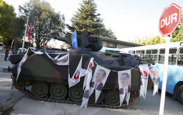 An Armored Vehicle with portraits of Turkish President Tayyip Erdogan is parked outside the parliament building in Ankara, Turkey, July 16, 2016. REUTERS/Baz Ratner