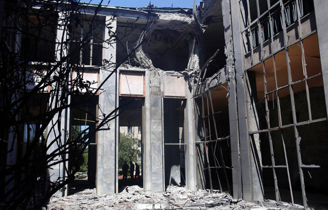 A picture taken on July 16, 2016 shows heavy damage at the Grand National Assembly of Turkey in Ankara after he was bombed by rebel jets. July 15 putsch bid began with rebel F-16 jets screaming low over rooftops in Ankara, soldiers and tanks taking to the streets and multiple explosions throughout the night in the capital as well as the biggest city Istanbul. With at least 2,839 soldiers already detained in a relentless round-up over the coup plot, the authorities blamed the conspiracy on Erdogan's arch enemy, the US-based cleric Fethullah Gulen. / AFP PHOTO / ADEM ALTAN
