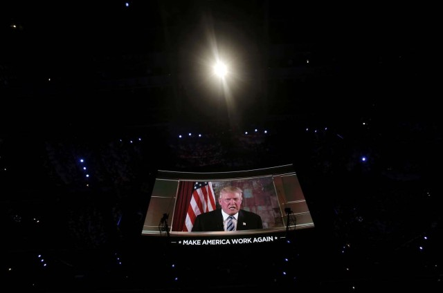 Republican presidential nominee Donald Trump appears on a video screen at the Republican National Convention in Cleveland, Ohio, U.S. July 19, 2016.  REUTERS/Mike Segar