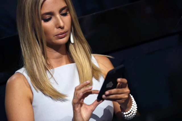 Ivanka Trump, daughter of Republican presidential nominee Donald Trump, texts at the Republican National Convention in Cleveland, Ohio, U.S. July 19, 2016. REUTERS/Jonathan Ernst
