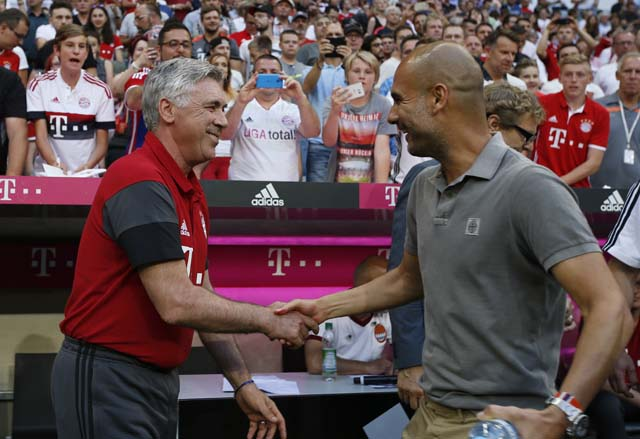 Football Soccer - Bayern Munich v Manchester City - Pre Season Friendly - Allianz Arena, Munich, Germany - 20/7/16 Manchester City manager Pep Guardiola with Bayern Munich coach Carlo Ancelotti before the match Action Images via Reuters / Michaela Rehle Livepic