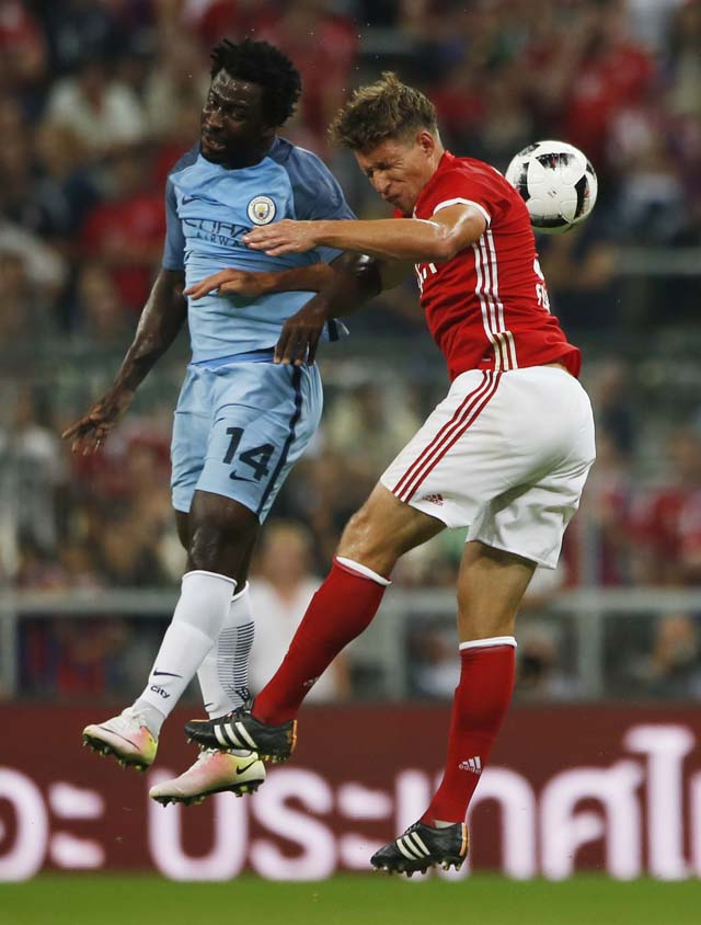 Football Soccer - Bayern Munich v Manchester City - Pre Season Friendly - Allianz Arena, Munich, Germany - 20/7/16 Manchester City's Wilfried Bony in action with Bayern Munich's Nicolas Feldhahn Action Images via Reuters / Michaela Rehle Livepic