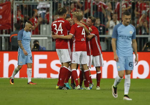 Football Soccer - Bayern Munich v Manchester City - Pre Season Friendly - Allianz Arena, Munich, Germany - 20/7/16 Erdal Ozturk celebrates with team mates after scoring the first goal for Bayern Munich Action Images via Reuters / Michaela Rehle Livepic
