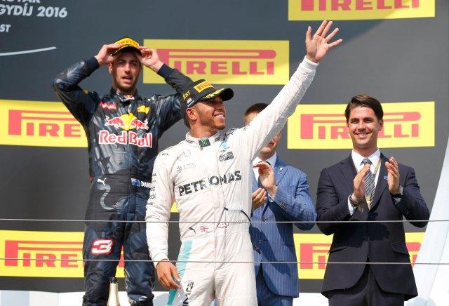 Hungary Formula One - F1 - Hungarian Grand Prix 2016 - Hungaroring, Hungary - 24/7/16 Mercedes' Lewis Hamilton celebrates after winning the race REUTERS/Laszlo Balogh