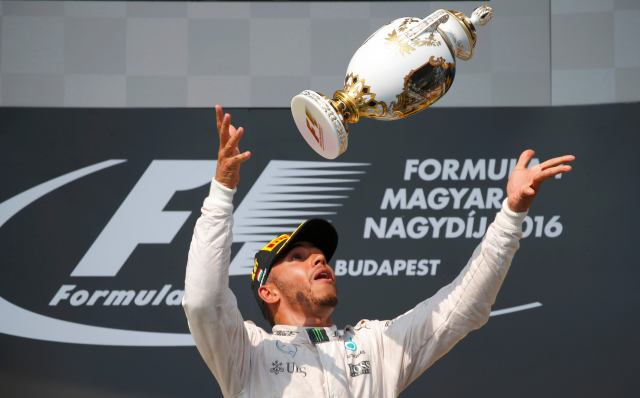 Hungary Formula One - F1 - Hungarian Grand Prix 2016 - Hungaroring, Hungary - 24/7/16 Mercedes' Lewis Hamilton celebrates after winning the race REUTERS/Laszlo Balogh TPX IMAGES OF THE DAY