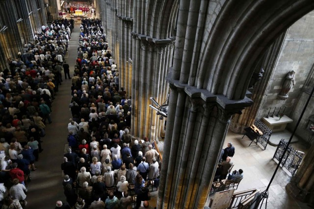 People attend a funeral service to slain French parish priest Father Jacques Hamel at the Cathedral in Rouen, France, August 2, 2016. Father Jacques Hamel was killed last week in an attack on a church at Saint-Etienne-du-Rouvray near Rouen that was carried out by assailants linked to Islamic State.   REUTERS/Charly Triballeau/Pool