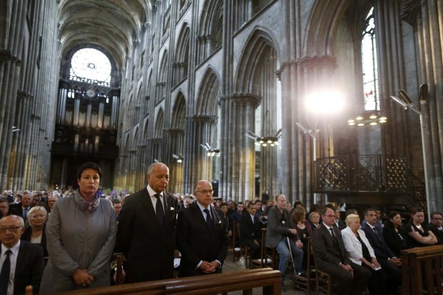 (From 2ndL) French Junior minister for Local Authorities Estelle Grelier, French President of the Constitutional Council Laurent Fabius and French Interior Minister Bernard Cazeneuve attend a funeral service to slain French parish priest Father Jacques Hamel at the Cathedral in Rouen, France, August 2, 2016. Father Jacques Hamel was killed last week in an attack on a church at Saint-Etienne-du-Rouvray near Rouen that was carried out by assailants linked to Islamic State.   REUTERS/Charly Triballeau/Pool