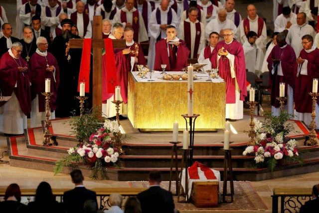 Archbishop of Rouen and Primate of Normandy Mgr Dominique Lebrun prays during a funeral service to slain French parish priest Father Jacques Hamel at the Cathedral in Rouen, France, August 2, 2016. Father Jacques Hamel was killed last week in an attack on a church at Saint-Etienne-du-Rouvray near Rouen that was carried out by assailants linked to Islamic State.   REUTERS/Charly Triballeau/Pool