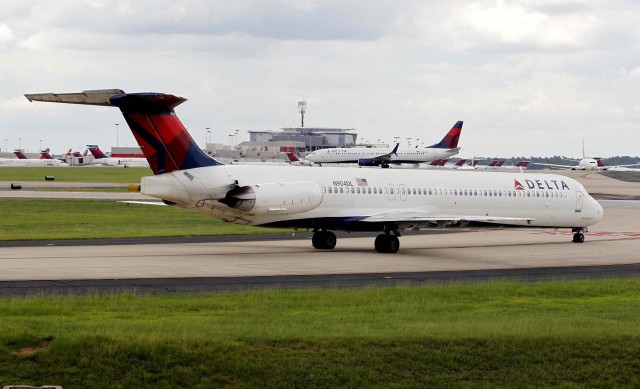 Delta airplanes line up on the taxi way after Delta Air Lines' computer systems crashed on Monday, grounding flights around the globe, at Hartsfield Jackson Atlanta International Airport in Atlanta, Georgia, U.S. August 8, 2016.  REUTERS/Tami Chappell