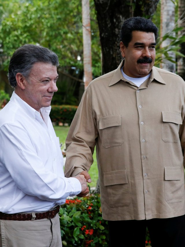 Venezuela's President Nicolas Maduro and Colombia's President Juan Manuel Santos shake hands during their meeting at Macagua Hydroelectric compound in Puerto Ordaz