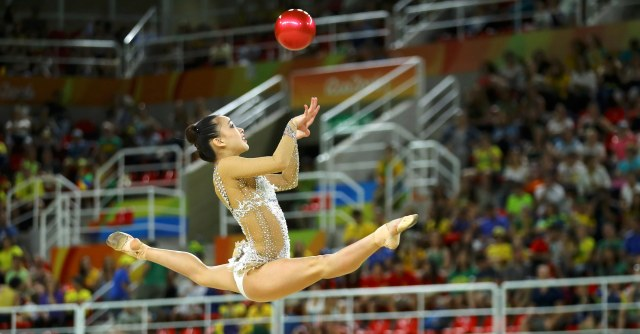 2016 Rio Olympics - Rhythmic Gymnastics - Preliminary - Individual All-Around Qualification - Rotation 1 - Rio Olympic Arena - Rio de Janeiro, Brazil - 19/08/2016. Son Yeon-Jae (KOR) of South Korea competes using the ball. REUTERS/Mike Blake FOR EDITORIAL USE ONLY. NOT FOR SALE FOR MARKETING OR ADVERTISING CAMPAIGNS.