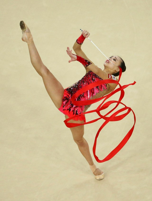 2016 Rio Olympics - Rhythmic Gymnastics - Preliminary - Individual All-Around Qualification - Rotation 3 - Rio Olympic Arena - Rio de Janeiro, Brazil - 19/08/2016. Son Yeon-Jae (KOR) of South Korea competes using the ribbon. REUTERS/Ruben Sprich FOR EDITORIAL USE ONLY. NOT FOR SALE FOR MARKETING OR ADVERTISING CAMPAIGNS.
