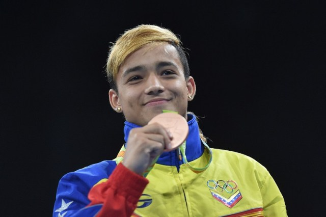 Bronze medalists Venezuela's Yoel Segundo Finol react during the medal presentation ceremony following the Men's Fly (52kg) Final Bout at the Rio 2016 Olympic Games at the Riocentro - Pavilion 6 in Rio de Janeiro on August 21, 2016. / AFP PHOTO / YURI CORTEZ