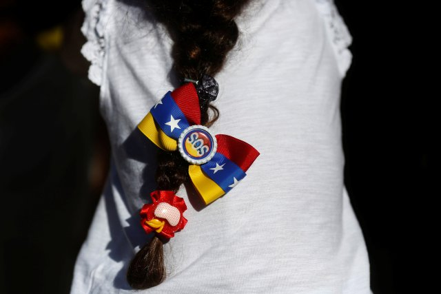 A girl takes part in a demonstration to demand a referendum to remove Venezuela's President Nicolas Maduro, in Madrid, Spain, September 4, 2016. REUTERS/Susana Vera
