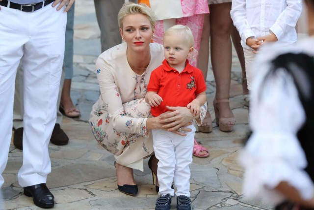 Princess Charlene of Monaco holds Prince Jacques, the heir apparent to the Monegasque throne during the traditional Monaco's picnic in Monaco, September 10, 2016. REUTERS/Valery Hache/Pool