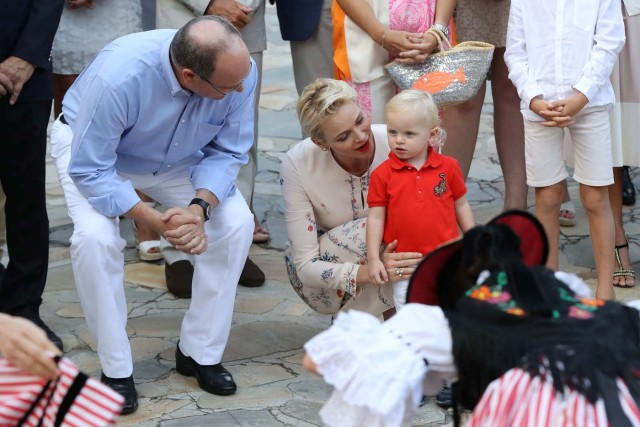 Prince Albert II of Monaco and his wife Charlene of Monaco attend a dance show with Prince Jacques, the heir apparent to the Monegasque throne during the traditional Monaco's picnic in Monaco, September 10, 2016. REUTERS/Valery Hache/Pool