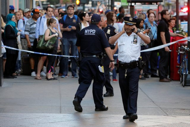 Police work at the scene where a man was shot by police in Manhattan, New York, U.S., September 15, 2016. REUTERS/Andrew Kelly