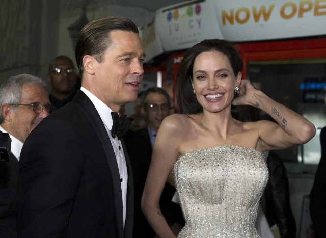"""Director and cast member Angelina Jolie and her husband and co-star Brad Pitt arrive at the premiere of """"By the Sea"""" during the opening night of AFI FEST 2015 in Hollywood, California, U.S. on November 5, 2015. REUTERS/Mario Anzuoni/File Photo"""