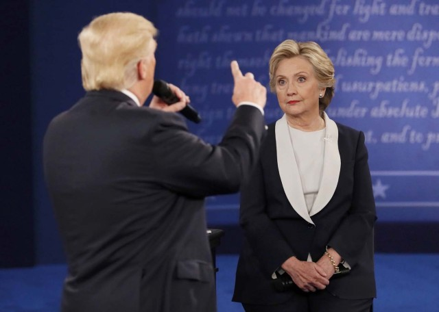Republican U.S. presidential nominee Donald Trump speaks during their presidential town hall debate with Democratic U.S. presidential nominee Hillary Clinton at Washington University in St. Louis, Missouri, U.S., October 9, 2016. REUTERS/Shannon Stapleton