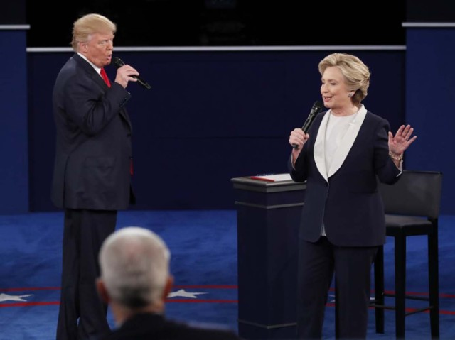 Donald Trump and Hillary Clinton speak. REUTERS/Jim Young
