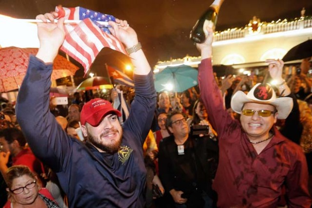 Cuban Americans celebrate upon hearing about the death of longtime Cuban leader Fidel Castro in the Little Havana neighborhood of Miami, Florida on November 26, 2016. Cuba's socialist icon and father of his country's revolution Fidel Castro died on November 25 aged 90, after defying the US during a half-century of ironclad rule and surviving the eclipse of global communism. / AFP PHOTO