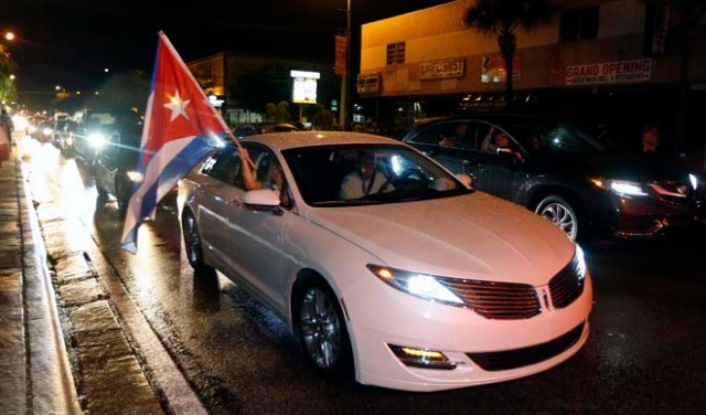 A Cuba flag is displayed from a car as Cuban Americans celebrate upon hearing about the death of longtime Cuban leader Fidel Castro in the Little Havana neighborhood of Miami, Florida on November 26, 2016. Cuba's socialist icon and father of his country's revolution Fidel Castro died on November 25 aged 90, after defying the US during a half-century of ironclad rule and surviving the eclipse of global communism. / AFP PHOTO