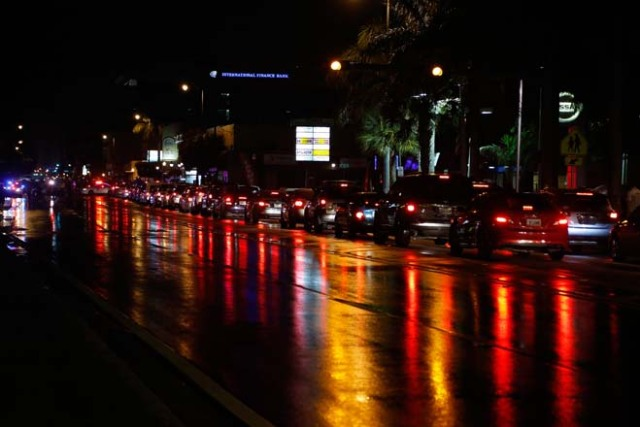 Cars line the street as Cuban Americans celebrate upon hearing about the death of longtime Cuban leader Fidel Castro in the Little Havana neighborhood of Miami, Florida on November 26, 2016. Cuba's socialist icon and father of his country's revolution Fidel Castro died on November 25 aged 90, after defying the US during a half-century of ironclad rule and surviving the eclipse of global communism. / AFP PHOTO / RHONA WISE