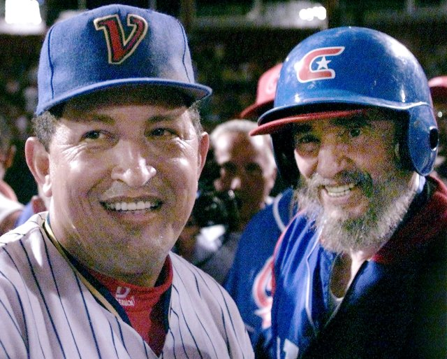 Then Cuban President Fidel Castro (R) and his Venezuelan counterpart Hugo Chavez chat on the field after taking part in a friendly baseball game between their two countries at the Barquisimeto baseball stadium in this October 29, 2000 file photo. Picture taken October 29, 2000. REUTERS/Andrew Winning/Files